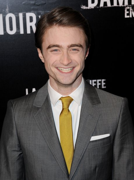 Daniel Radcliffe as a grown man in a suit