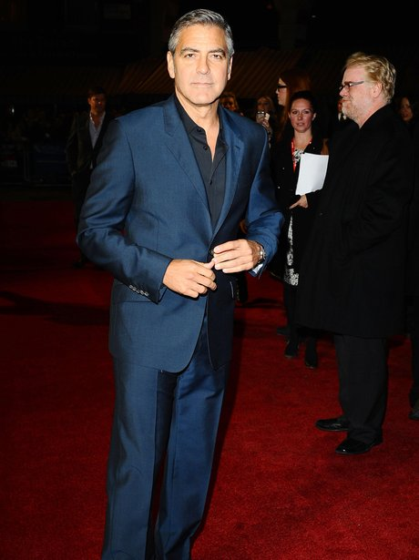 George Clooney in blue suit on red carpet