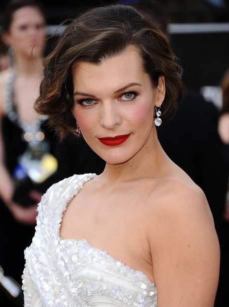 Milla Jovovich arrives for the Oscars Academy Awar