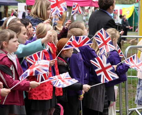 Crowds wave flags for The Queen