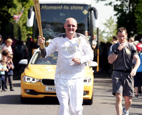 Christopher carries the Olympic Flame