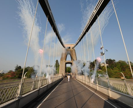 Fireworks and Olympic Torch on Suspension Bridge