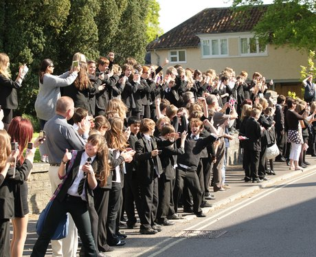 School children line the streets