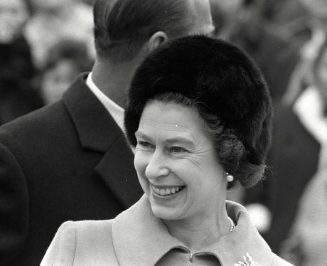 The Queen smiling in a black and white photograph