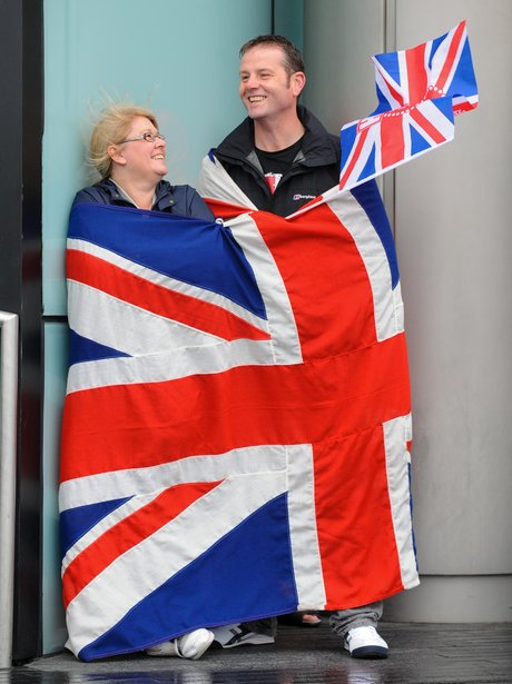 A couple wear the flag with pride
