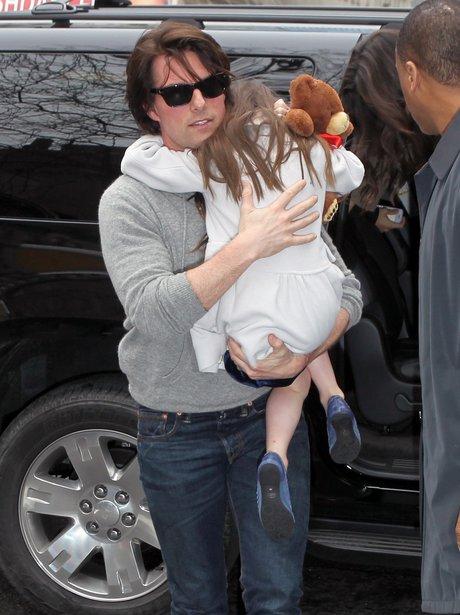 Tom Cruise cuddles Suri Cruise