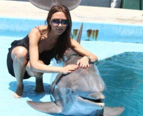 Victoria Beckham with dolphin