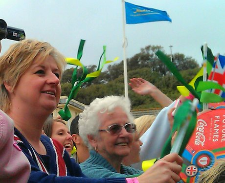 The crowds enjoying the torch evening celebrations