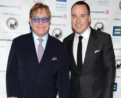 Sir Elton John and David Furnish visit the AIDS Memorial Quilt at The National Mall