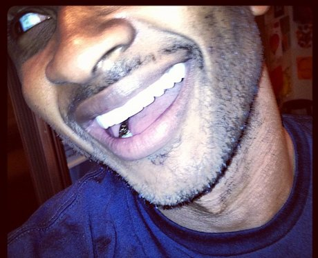 Usher shows off his gold teeth