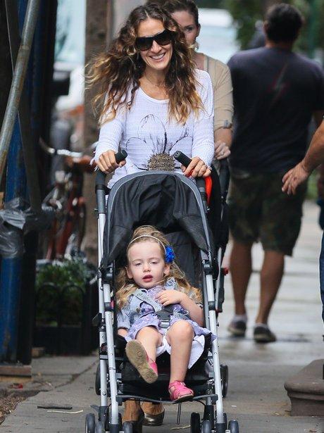 Sarah Jessica Parker pushing daughter in pushchair