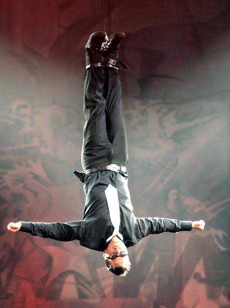 Robbie williams performing live at Knebworth.