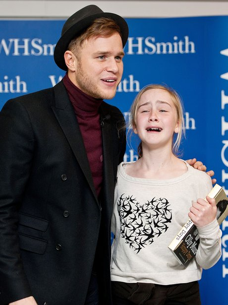Olly Murs with crying fan at his book signing