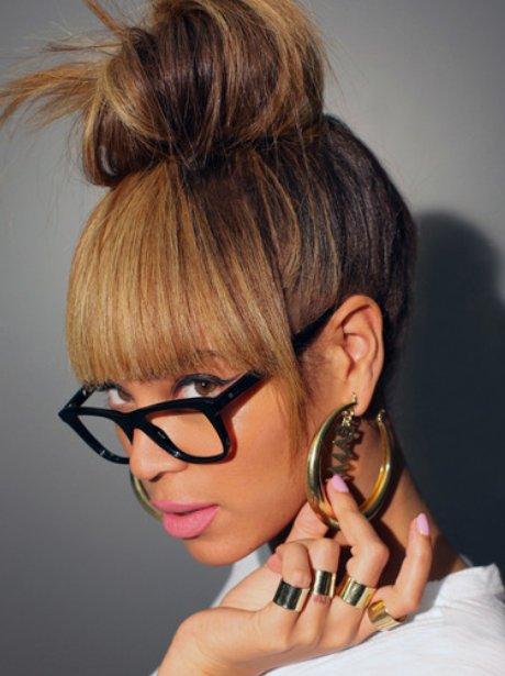 Beyonce wearing glasses with hoop earrings