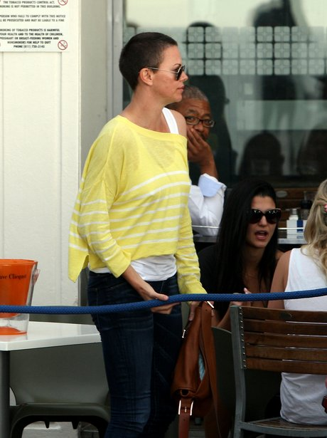 Charlize Theron with new shaved hair cut