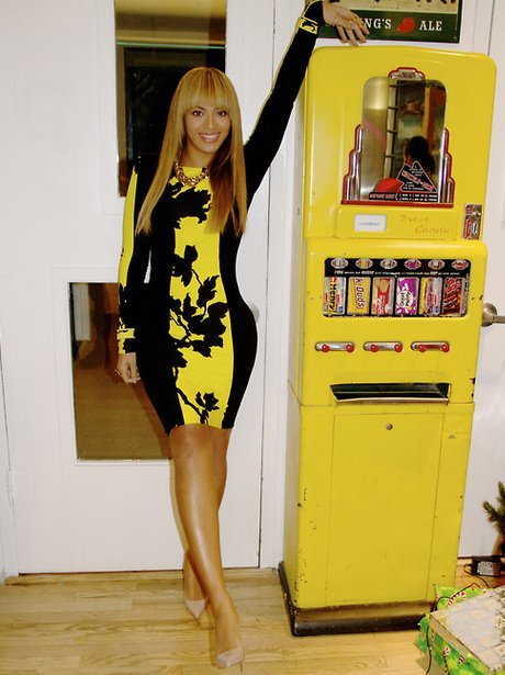 Beyonce next to a vending machine