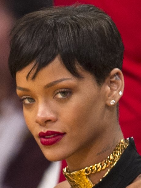 Rihanna watches basketball with chris brown