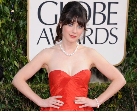 Zooey Deschenal on the red carpet in a red dress at the Golden Globe Awards 2013