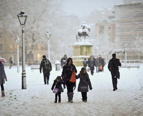 People walk through the snow in Bristol