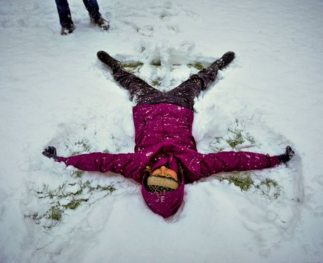Girl doing snow angels