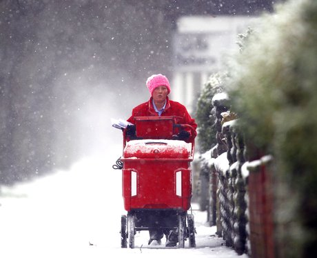 Post man in the snow in Liverpool