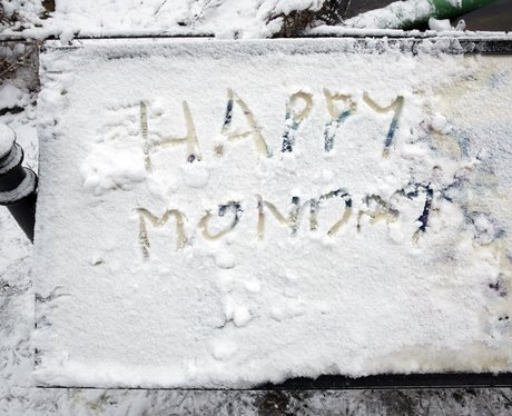 Happy Monday written in the snow