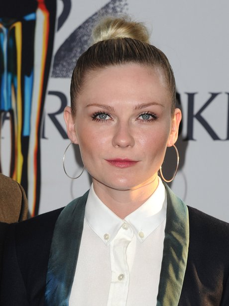 Kirsten Dunst wearing a top knot