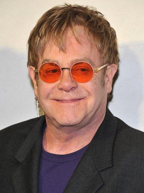 Elton in orange glasses