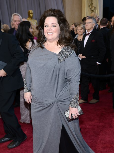 Melissa McCarthy attends the Oscars 2013 Red Carpe