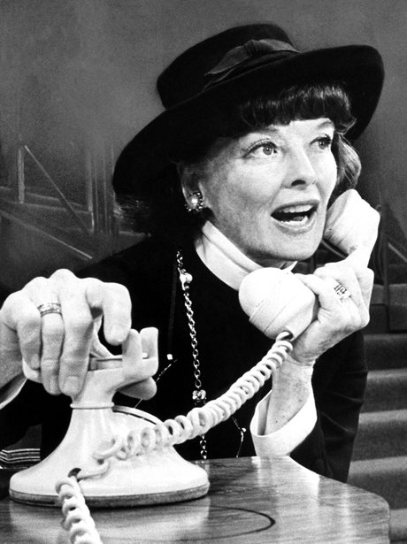 Katharine Hepburn using a retro telephone