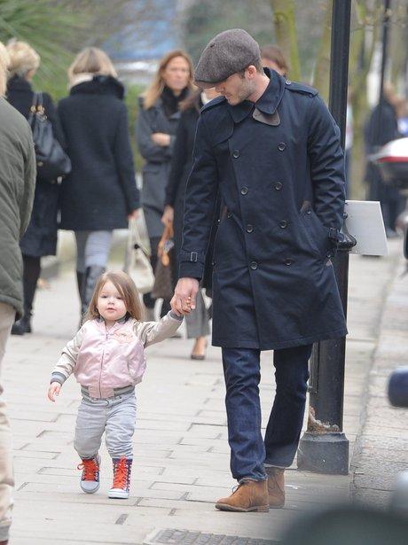 David Beckham and Harper walking in London