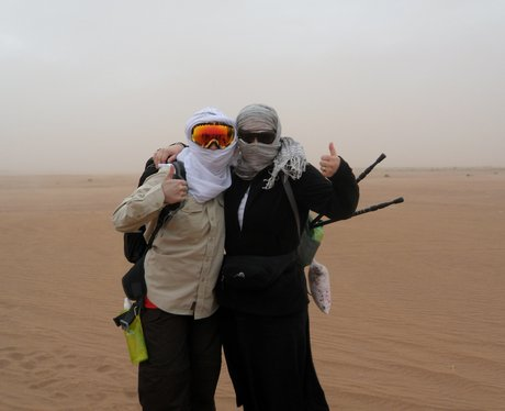 Trekkers protecting themselves from the sand