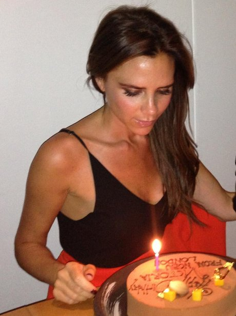 Victoria Beckham blows out candles on birthday cake
