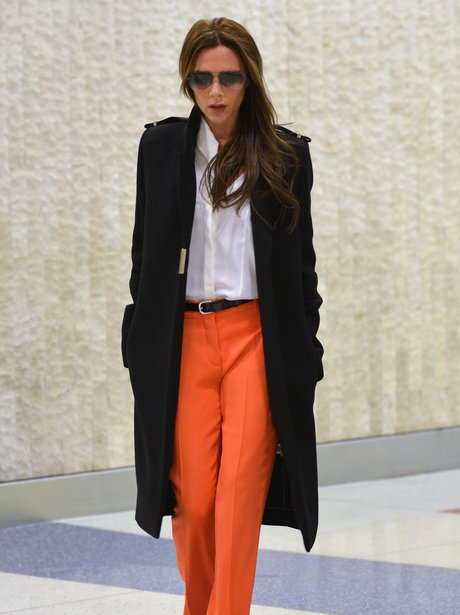 Victoria Beckham in orange trousers