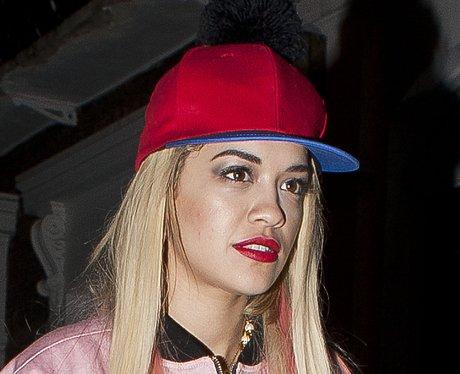 Rita Ora wearing a red cap