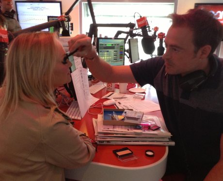 Jamie Theakston making up Emma Bunton