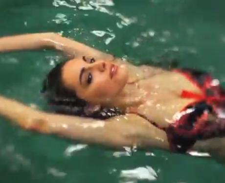Kelly Brook swims back stroke in pool