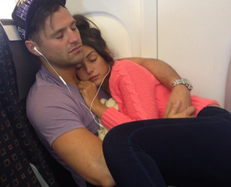 Mark Wright and Michelle Keegan sleeping on an aeroplane