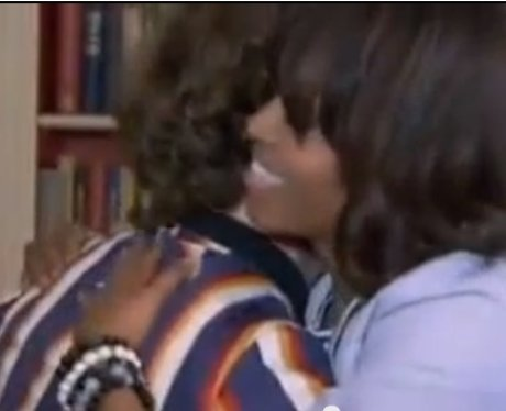 Michelle Obama hugs Jay McGuinness.