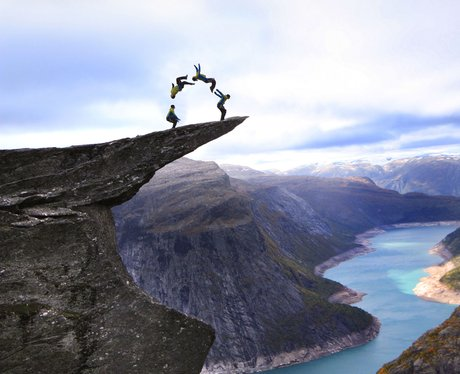 Daredevils Perform Stunts At Troll's Tongue Norway