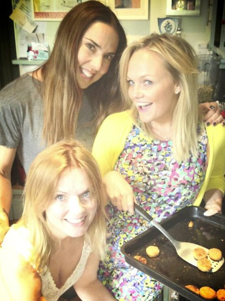 Mel C, Emma Bunton and Geri Halliwell cooking together