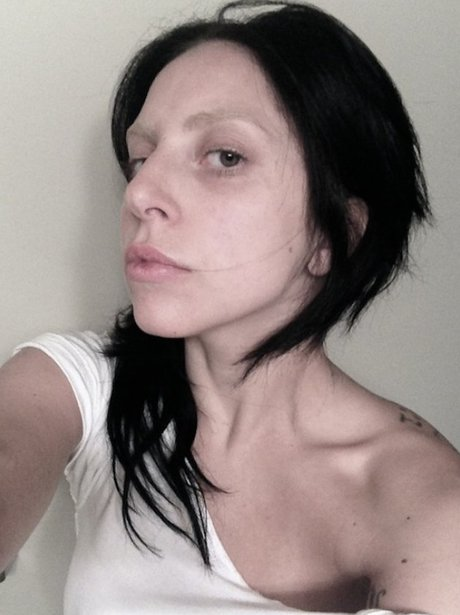Lady Gaga with black hair in selfie with no makeup
