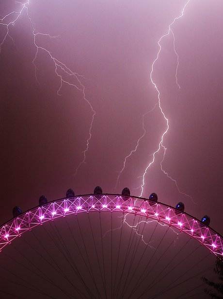 Lightning strikes behind The London Eye