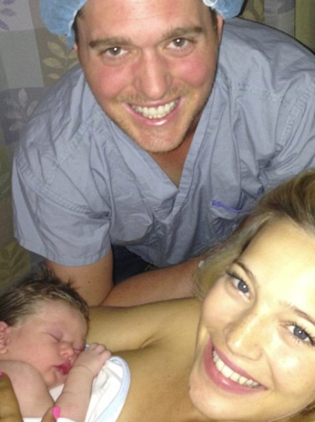 Michael Buble in hospital cap as Luisana holds baby Noah
