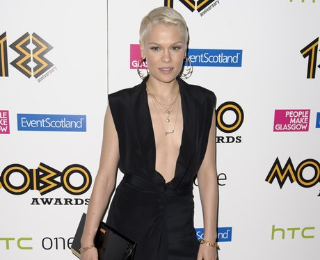 Jessie J in a black jump suit and gold hoop earrings at the MOBO Awards October 2013