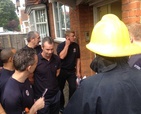 Firemen walk through Watford town centre on strike