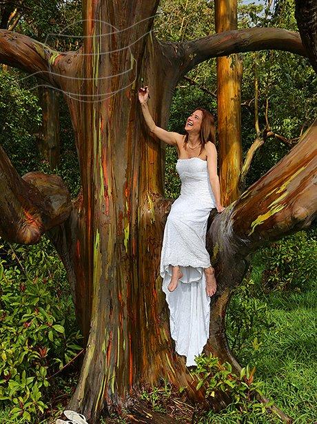 Woman posing around the world in her wedding dress