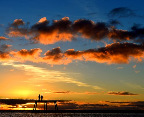 The sun rises over a sculpture in Northumberland.