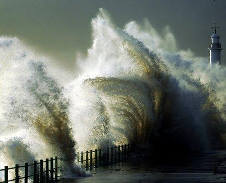 Waves crashing against a lighthouse