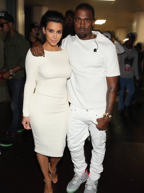 Kim Kardashian and Kanye West dressed in white